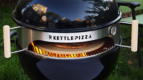 Pizza oven in a black gas grill
