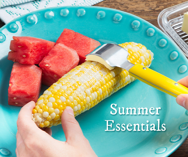 Summer essentials: A plate of watermelon and corn on the cob gets buttered with ButterOnce's corn buttering knife