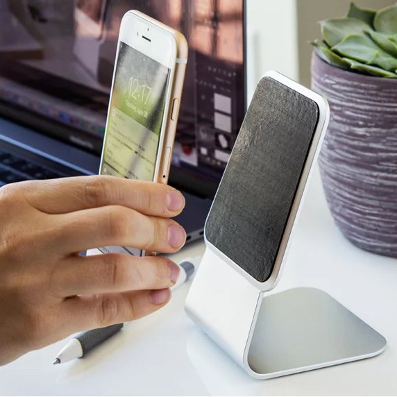This brushed aluminum smartphone stand uses micro-suction to hold your phone in place.