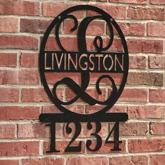 Black monogrammed sign with name and street number