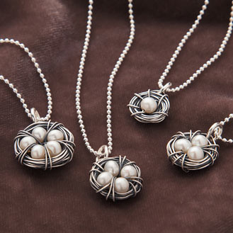 Four nest necklaces with pearls