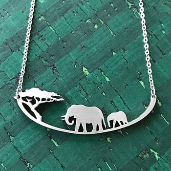 This necklace depicts two elephants and a tree in silhousette.