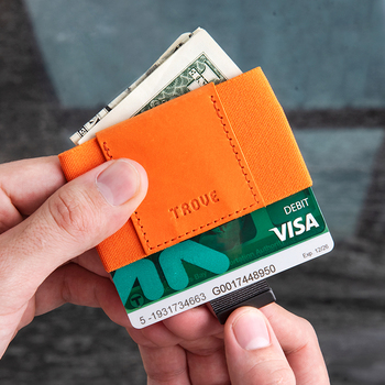 This orange elastic and leather minimalist wallet holds credit cards and cash in a super-slim design.